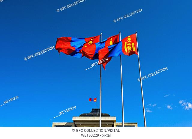 National flag of Mongolia with the Soyombo national symbol at the Parliament building at Sukhbaatar Square, Ulaanbaatar, Mongolia