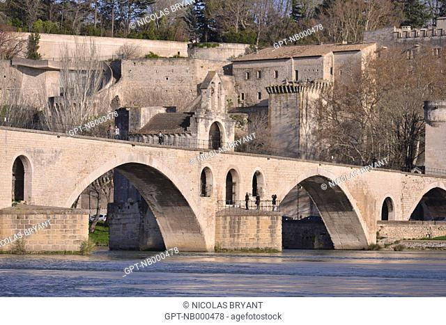 THE SAINT-BENEZET BRIDGE, MORE COMMONLY CALLED THE BRIDGE OF AVIGNON, ONCE CROSSED THE RHONE BUT A PART OF IT WAS DESTROYED AND STILL TODAY HAS NOT BEEN REBUILT