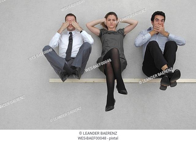 Three business people, See no evil, hear no evil, and speak no evil, elevated view