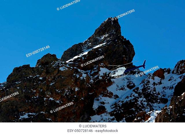 Helicopter fly above Mount Ruapehu, the highest mountain in the North Island of New Zealand