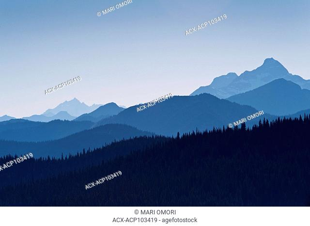 Layers of blue mountains of the Cascade Range can be seen from the Heather trail in Manning Park