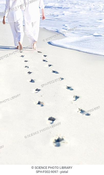 Couple walking along a beach