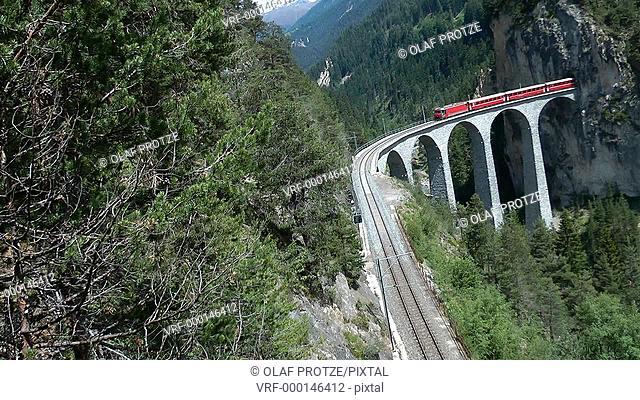 Glacier Express at the Landwehr Viaduct in the Swiss Alps, Switzerland