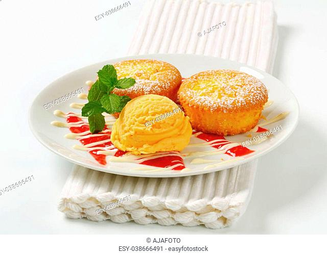 Custard filled muffins with scoop of ice cream