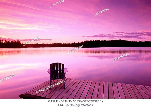 Lifestyles. Early dusk. Adirondack chair at lake. Near Anchorage. Southcentral Alaska. USA