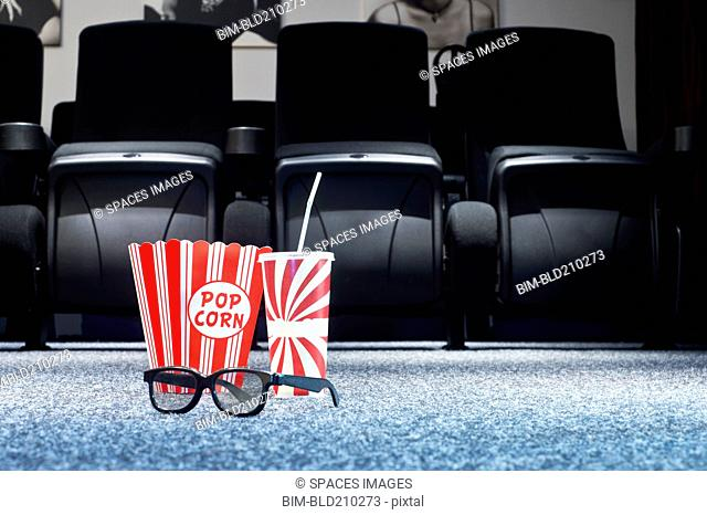 3D glasses, popcorn and soda in home theater