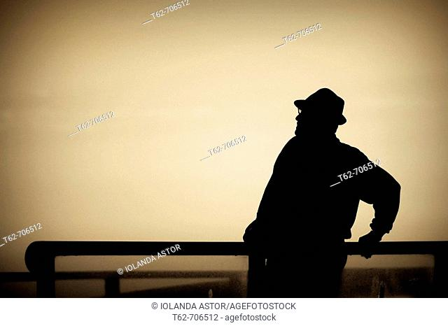 Silhouette of a man with backlight, resting