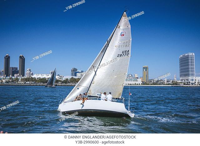 Sail boat heeling over on a windy day on San Diego Bay