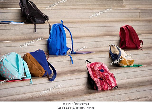 Backpacks left on bleachers