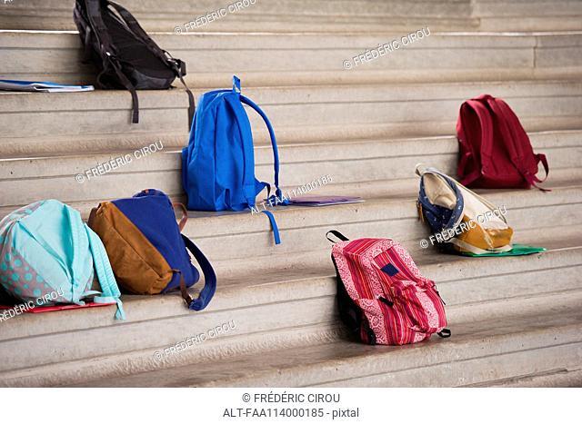 Backpacks left on bleachers