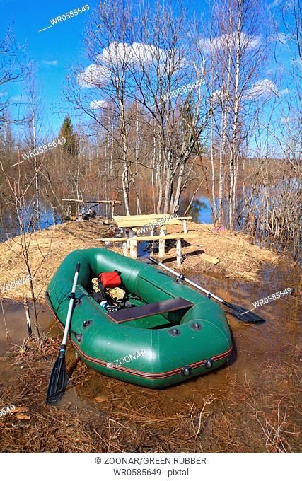 green rubber boat near coast