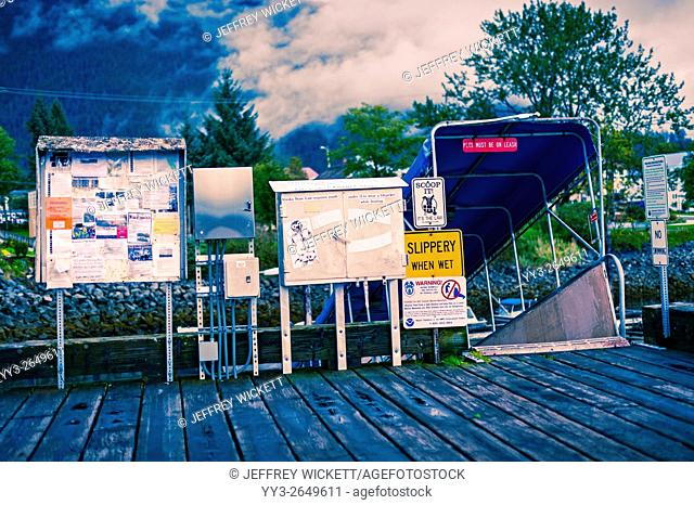 Kiosk and bill boards at the walkway down to Crescent Harbor in Sitka, Alaska, USA
