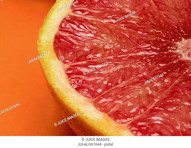Close-up of red grapefruit, cut in half