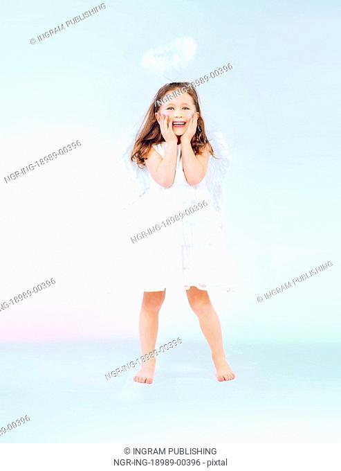 Cute little girl as an pretty angel