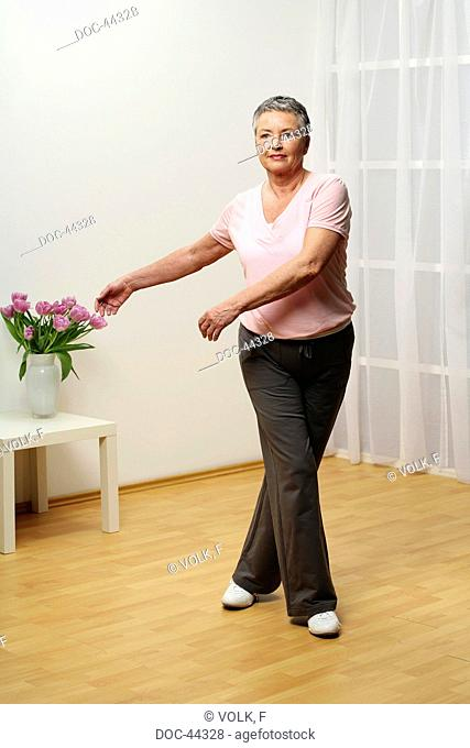 older woman doing gymnastics - cross-over - senior