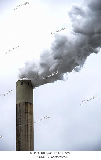 chimney with smoke and cloudy sky