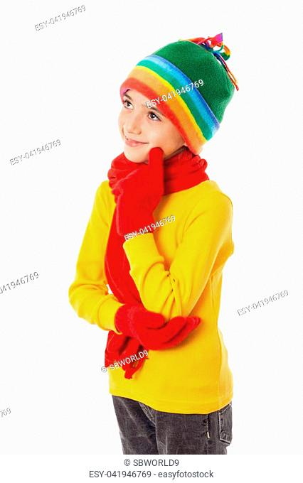 Thoughtful girl in colorful winter clothes, isolated on white