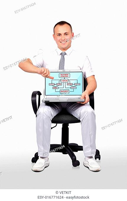 businessman sitting on chair and holding laptop with business scheme