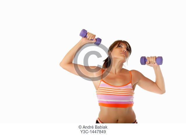 Woman exercising with bar-bells