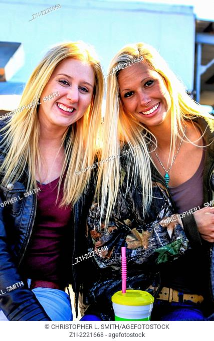 College girls enjoying a day out at the Cortez Fish Festival Florida
