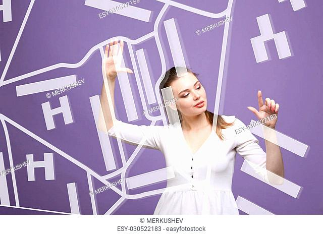 Future technology, navigation, location concept. Woman showing transparent screen with gps navigator map. Violet background