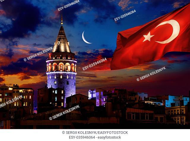 Turkish flag illuminated Galata Tower in Istanbul at night, Turkey