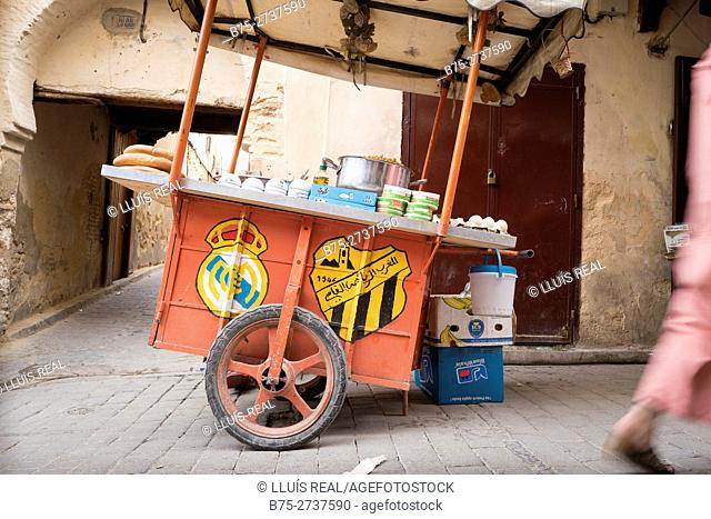 Street food stand with emblems of Real Madrid and MAS Fez. Fez, Morocco