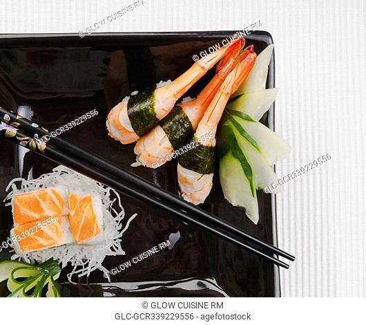 High angle view of assorted sushi on a platter with chopsticks