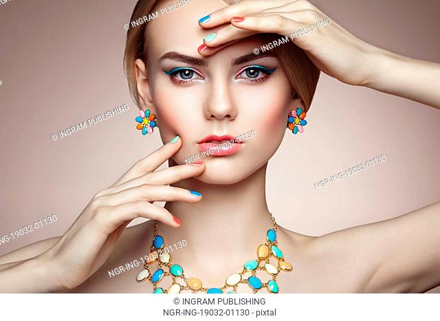 Portrait of beautiful sensual woman with elegant hairstyle. Perfect makeup. Blonde girl. Fashion photo. Jewelry