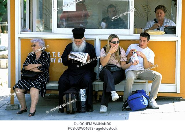 Athens, waiting for the bus with orthodox priest