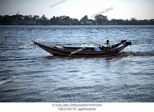 A long boat at the Irrawaddy River in Yangon, Myanmar