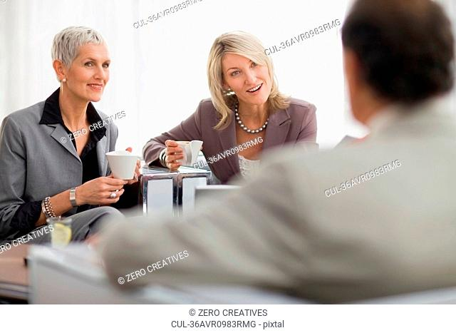 Business people having coffee together