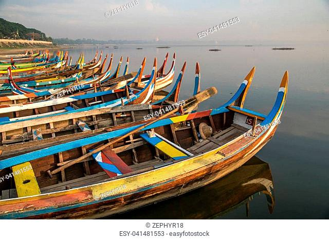 group of traditional boat in Taungthaman Lake near the U Bein Bridge, famous landmark and tourist attraction of Amarapura Township, Mandalay, Myanmar (Burma)