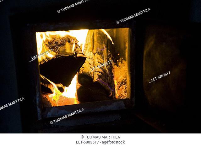 Wood burn in the stove of a Finnish sauna  Helsinki, Finland