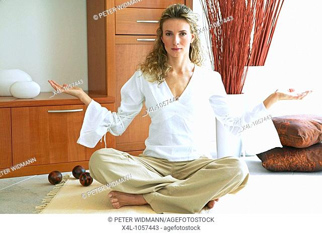woman relaxing with yoga exercise at home