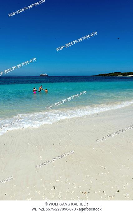 Cruise ship Safari Voyager at anchor in front of the white sand beach on Iguana Island in Panama