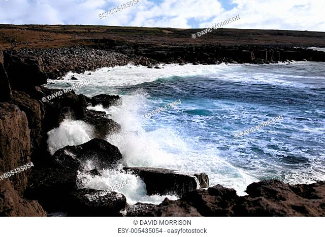 wave crashing on coast cliffs