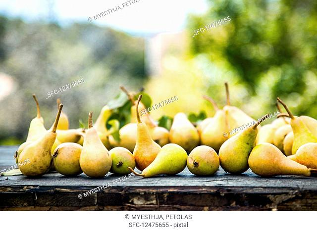 Pears on a wooden table outside