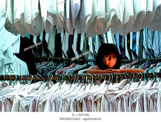 Vietnamese girl in shirt shop, Vietnam