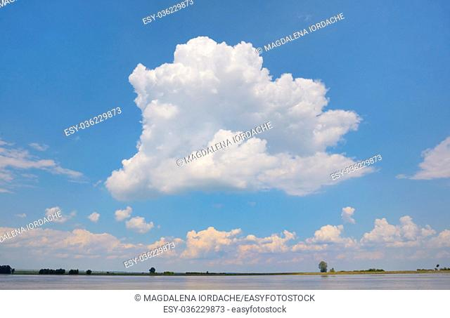 Cloud on blue sky on Danube river