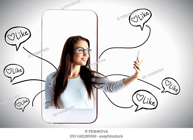 Happy young woman with smartphone getting likes. Social media and communication concept