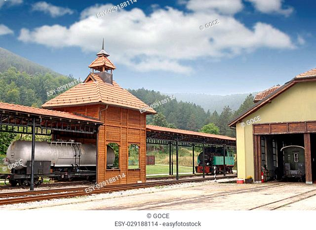 old railway station with steam locomotive