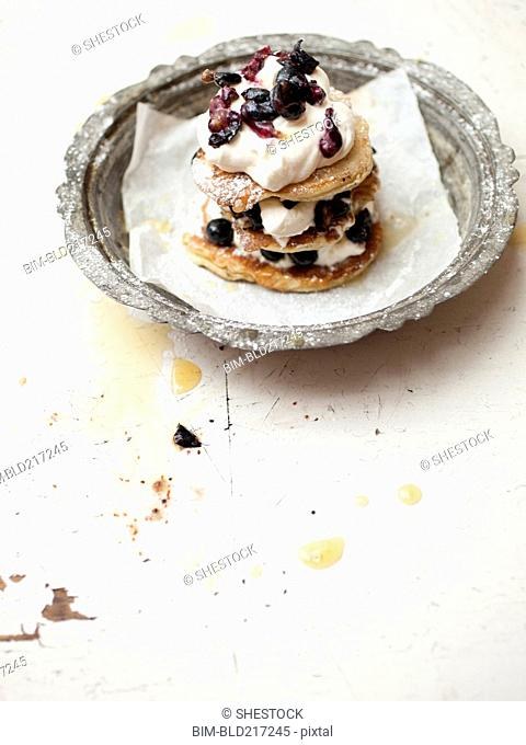 Stack of cookies with fruit and cream