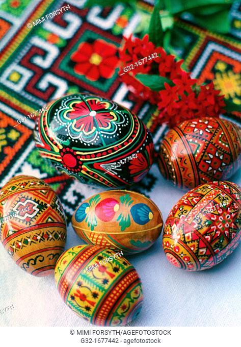 Ukrainian folk designs on Easter eggs, on cloth with Ukrainian folk embroidered designs