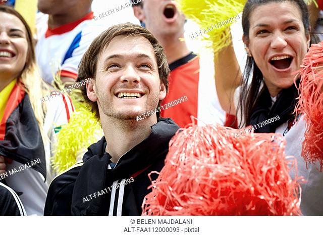 German football fans cheering at match