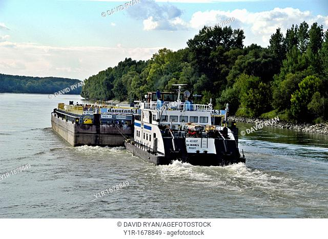 The Aurora pushes a tanker barge upstream on the Danube River