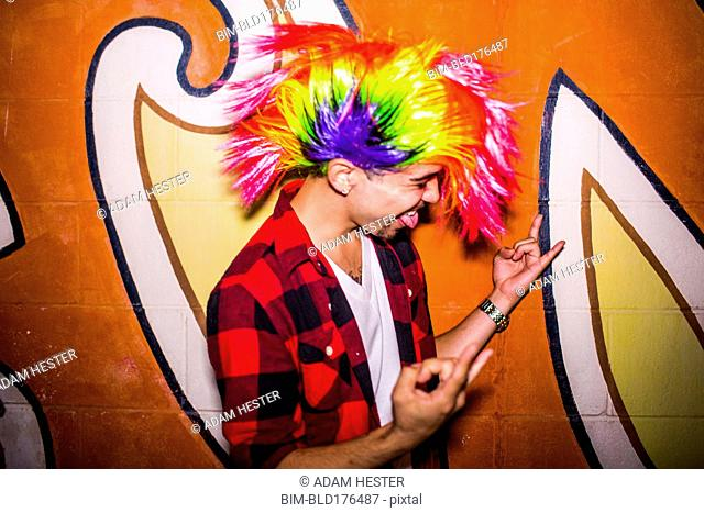 Hispanic man wearing colorful wig