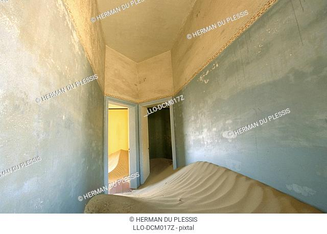 Two doors in a deserted house, half filled with sand, Kolmankop, Namibia