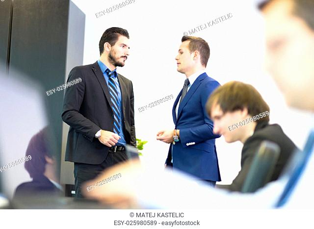Workplace in modern office with business people brainstorming. Businessman working on laptop during the meeting. Business and entrepreneurship concept