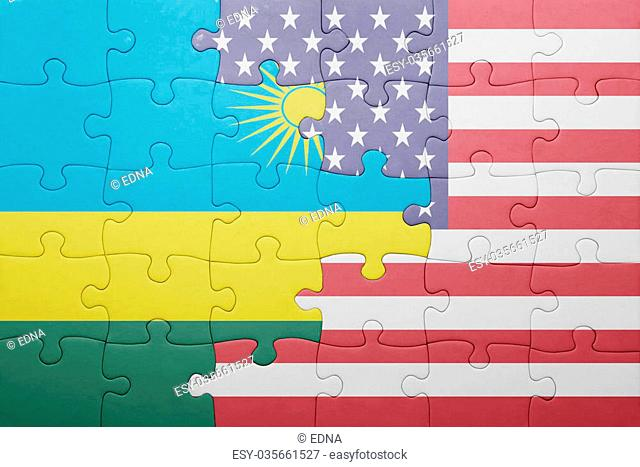 puzzle with the national flag of united states of america and rwanda .concept